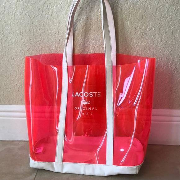ee1ccd87180 Lacoste Handbags - Lacoste • Pink Transparent PVC Bag